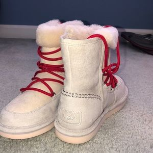 Cream Ugh boots with red laces